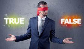 Man with ribbon on his eye making decision Stock Photo