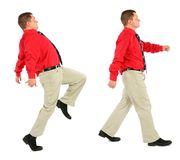 Businessman in red shirt goes Stock Photography