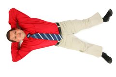 Businessman in  red shirt lay on his back Stock Image