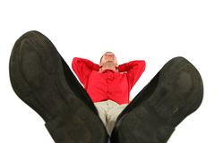 Businessman at red shirt lies by feet forward Stock Photo