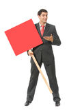 Businessman with red signboard Royalty Free Stock Photography