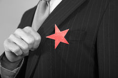 Businessman With Red Star On Suit Stock Photos