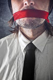 Businessman with red strip over mouth Royalty Free Stock Image