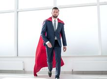 Businessman in a red superhero cloak. royalty free stock images