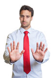 Businessman with red tie say stop Royalty Free Stock Photos