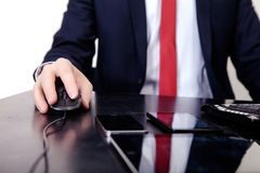 Businessman in red tie working on the computer. On the table is. A contract, pen, phone Royalty Free Stock Photo