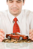 Businessman with red toy car Royalty Free Stock Image