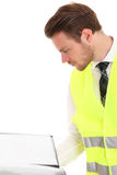 Businessman in a reflective vest Stock Photography