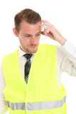 Businessman in a reflective vest Royalty Free Stock Image