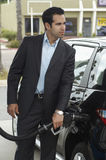 Businessman Refueling Car Stock Photography