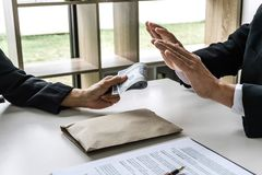 Businessman refuse receive bribe money the form of dollar bills from woman while give success the deal, Bribery and anti- stock photography