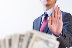 Businessman refuses to receive money - no bribery and corruption Royalty Free Stock Images