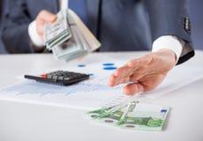Businessman refusing euro and choosing dollars Stock Photo