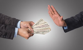 Businessman refusing the money offered by businessman on white b Stock Photos