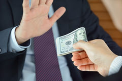 Businessman refusing money, uncorrupted concept Royalty Free Stock Photos