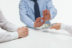 Businessman refusing money Stock Images