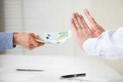 Businessman refusing to take a bribe Stock Image