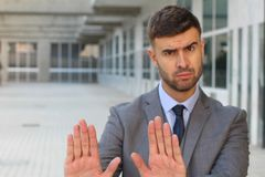 Businessman rejecting an inappropriate proposal Royalty Free Stock Photo