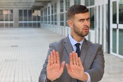 Businessman rejecting an inappropriate proposal.  stock image