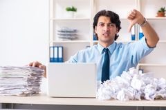The businessman rejecting new ideas with lots of papers. Businessman rejecting new ideas with lots of papers stock photography