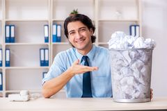 The businessman rejecting new ideas with lots of papers. Businessman rejecting new ideas with lots of papers royalty free stock image