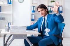 Businessman rejecting new ideas with lots of papers. The businessman rejecting new ideas with lots of papers stock images