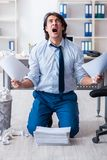 Businessman rejecting new ideas with lots of papers. The businessman rejecting new ideas with lots of papers royalty free stock photography