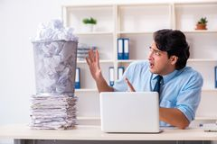 Businessman rejecting new ideas with lots of papers. The businessman rejecting new ideas with lots of papers stock photos