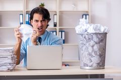The businessman rejecting new ideas with lots of papers. Businessman rejecting new ideas with lots of papers stock photos