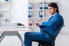 The businessman rejecting new ideas with lots of papers. Businessman rejecting new ideas with lots of papers stock photo