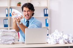 The businessman rejecting new ideas with lots of papers. Businessman rejecting new ideas with lots of papers royalty free stock photos