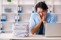 Businessman rejecting new ideas with lots of papers. The businessman rejecting new ideas with lots of papers stock photo