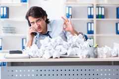 Businessman rejecting new ideas with lots of papers. The businessman rejecting new ideas with lots of papers royalty free stock photo