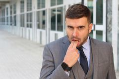 Businessman rejecting something with inappropriate hand gesture.  stock photo