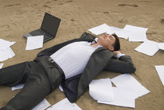 Businessman relax on the beach Stock Images