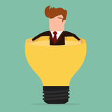 Businessman relax and soaking in lightbulb idea Royalty Free Stock Image