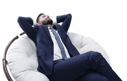 Businessman relaxarea comfortable chair. Confident businessman relaxarea comfortable chair.isolated on white Royalty Free Stock Image
