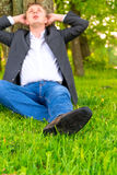 Businessman relaxes on a lawn Royalty Free Stock Photos