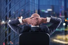 Businessman that relaxes in office and think about the future. double exposure stock photo