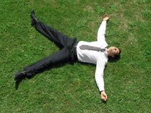 Businessman relaxing. After a hard day's work, he can finally rest stock images