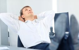 Businessman relaxing Stock Images