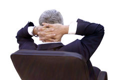 Businessman relaxing. Man lying in his executive chair Royalty Free Stock Image