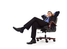 Businessman relaxing in armchair Stock Photography