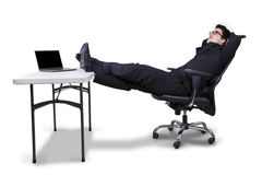 Businessman relaxing on armchair Royalty Free Stock Photography