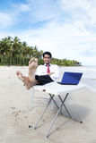 Businessman relaxing at beach Stock Photography