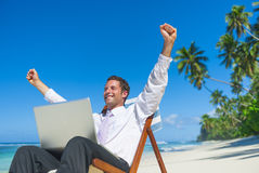 Businessman relaxing on the beach Royalty Free Stock Image