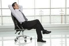 Businessman Relaxing in Chair Royalty Free Stock Images