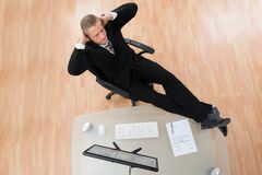 Businessman Relaxing On Chair Stock Photography