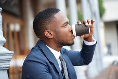 Businessman relaxing with a cup of coffee during a break Stock Photos