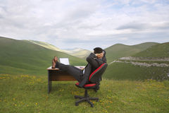 Businessman Relaxing With Feet On Desk In Field Royalty Free Stock Photography
